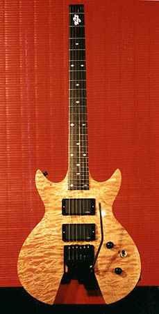 Headless guitar with quilted maple top and Trem.